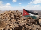 Jordan Flag on Mountain Peak - Wadi Rum Desert Tours